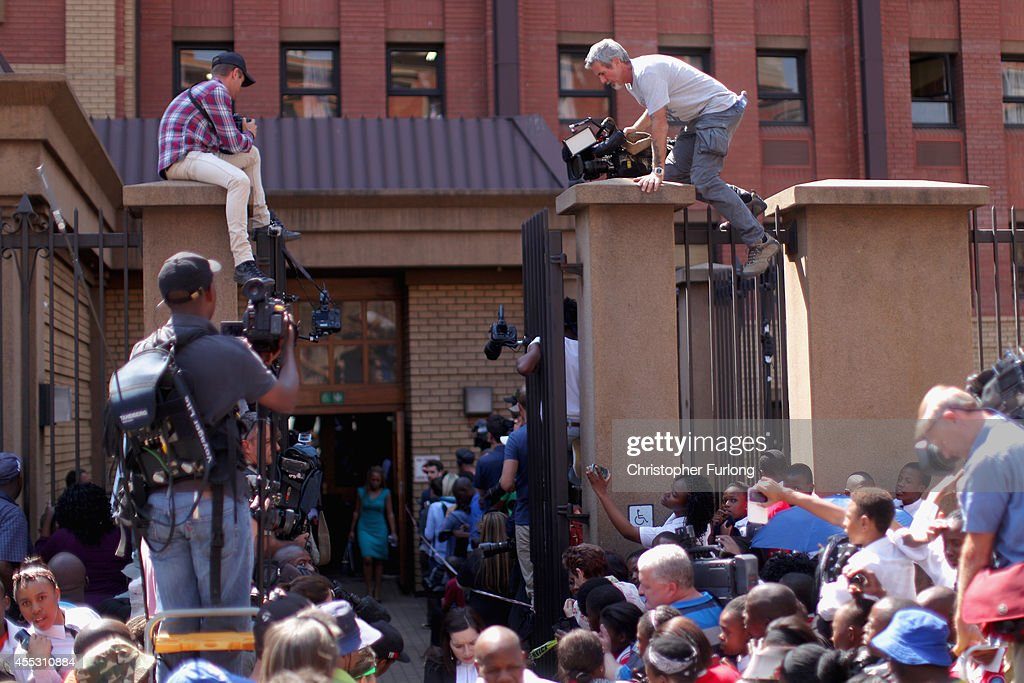 Television cameramen scale the walls of Gauteng High Court to get a glimpse Oscar Pistorius leaving on bail from the North Gauteng High Court on...