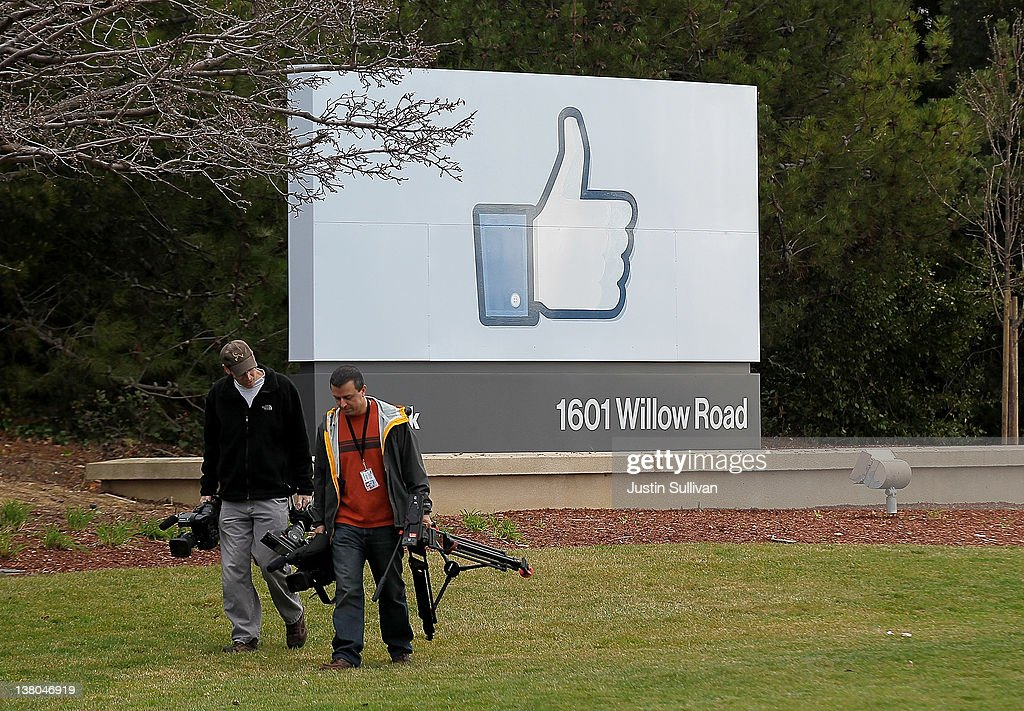 Television cameramen walk away from a sign standing in front of the Facebook headquarters on February 1, 2012 in Menlo Park, California. Facebook is expected to file for its first initial public offering today seeking to raise at least $5 billion.