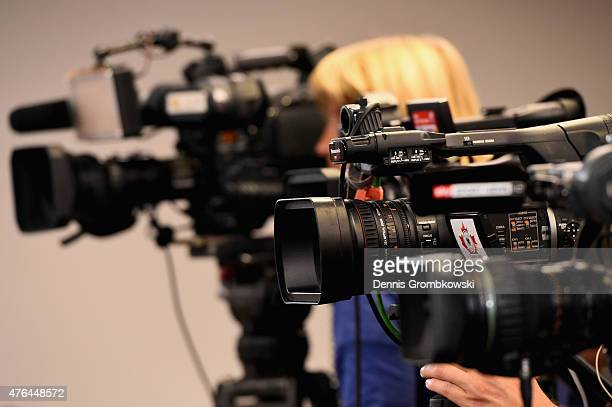 Television cameras are seen during a press conference at The Shaw Centre on June 9 2015 in Ottawa Canada
