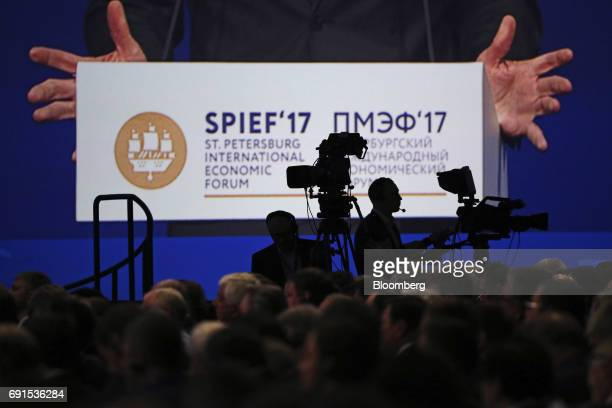 Television cameras broadcast the speech of Christian Kern Austria's chancellor at the plenary session during the St Petersburg International Economic...