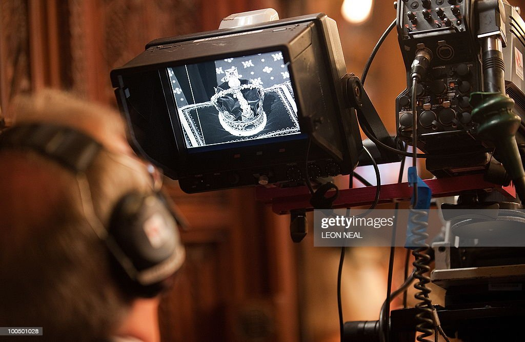 A television camerman watches a live feed of the Imperial State Crown being carried, before Britain's Queen Elizabeth II addressed the House of Lords for the State Opening of Parliament, at the Houses of Parliament, in Westminster, central London on May 25, 2010. Britain's Queen Elizabeth II set out the new coalition government's legislative programme on Tuesday in a ceremony of pomp and history following the closest general election for decades. AFP PHOTO/Leon Neal/Pool