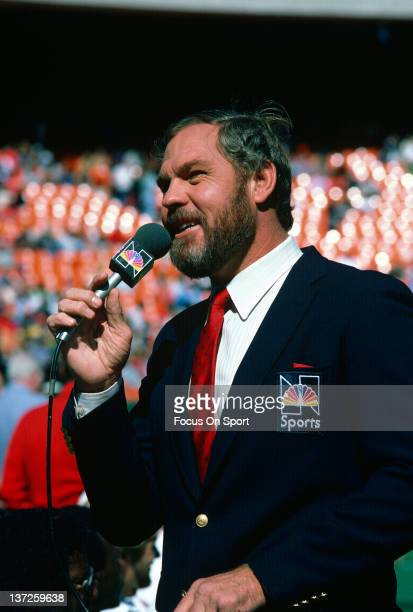 NBC television color commentator Merlin Olsen on the field broadcasting before an NFL football game circa 1984 Olsen was a color commentator for NBC...