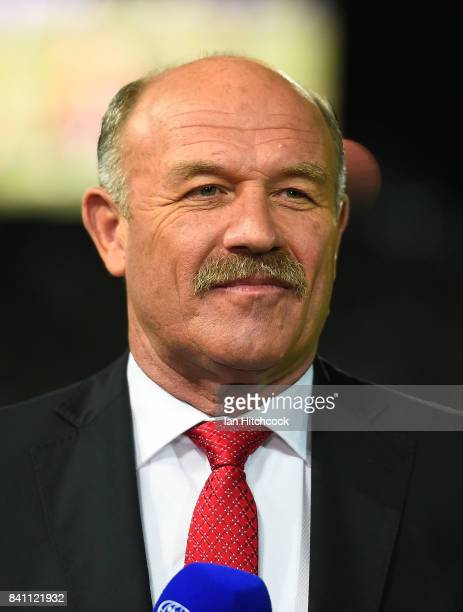 Television commentator and former NRL player Wally Lewis looks on before doing a piece to camera before the start of the round 26 NRL match between...
