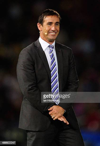 Television commentator Andrew Johns looks on before the start of the round nine NRL match between the North Queensland Cowboys and the Brisbane...