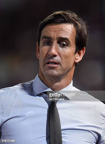 Television commentator Andrew Johns looks on during the round three NRL match between the North Queensland Cowboys and the Sydney Roosters at...