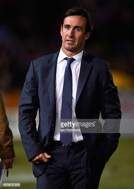 Television commentator Andrew Johns walks from the field before the start of the round 23 NRL match between the North Queensland Cowboys and the...