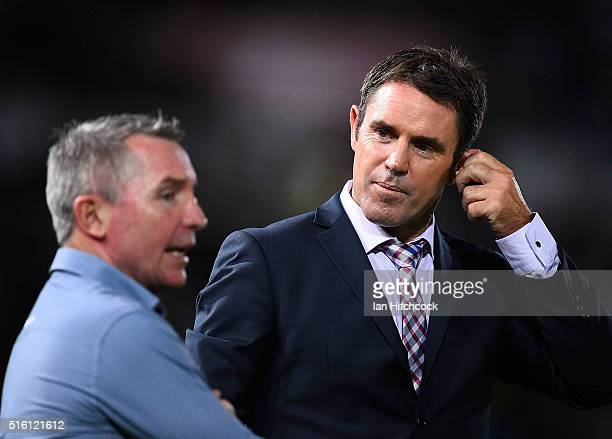 Television commentator Brad Fittler speaks with Cowboys coach Paul Green before the start of the round three NRL match between the North Queensland...