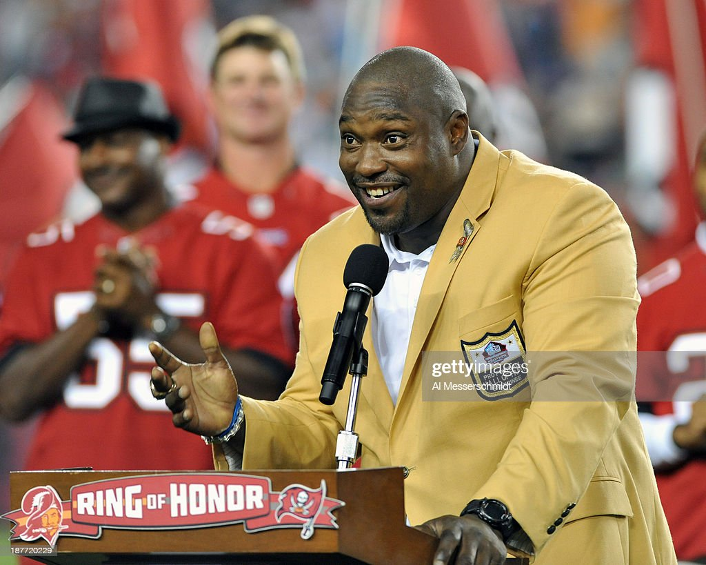 NFL television commentator <a gi-track='captionPersonalityLinkClicked' href=/galleries/search?phrase=Warren+Sapp&family=editorial&specificpeople=162706 ng-click='$event.stopPropagation()'>Warren Sapp</a> receives his NFL Hall of Fame ring during halftime ceremonies as the Tampa Bay Buccaneers play against the Miami Dolphins November 11, 2013 at Raymond James Stadium in Tampa, Florida. Tampa won 22 - 19.