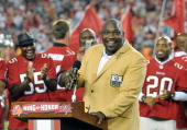 NFL television commentator Warren Sapp receives his NFL Hall of Fame ring during halftime ceremonies as the Tampa Bay Buccaneers play against the...