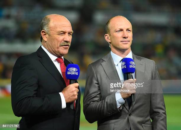 Television commentators and former NRL players Wally Lewis and Darren Lockyer do a piece to camera before start of the round 26 NRL match between the...