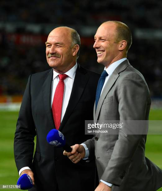 Television commentators and former NRL players Wally Lewis and Darren Lockyer share a laugh before doing a piece to camera before start of the round...
