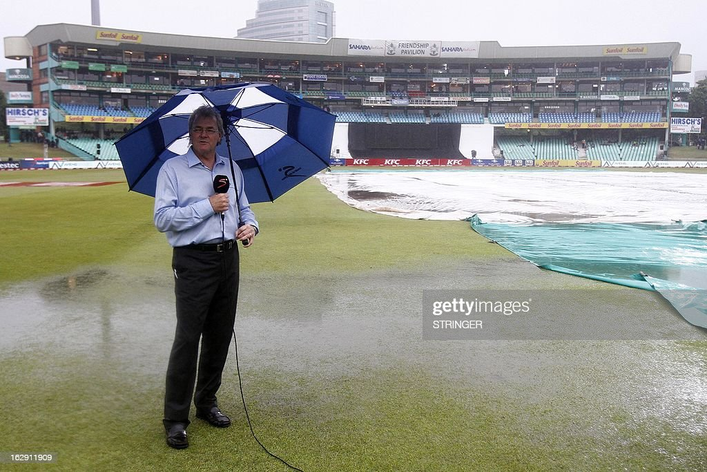 Television commentators do their report in the rain during the 1st T20 match between South Africa and Pakistan on March 1, 2013 at Sahara Stadium in Durban, South Africa. Steady rain threatened to wash out the first Twenty20 international between South Africa and Pakistan at Kingsmead here on Friday.
