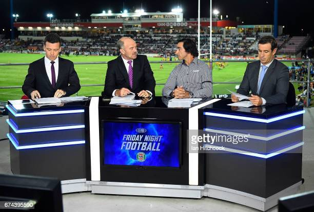 Television commentators from channel nine Wally Lewis Johnathan Thurston of the Cowboys and Andrew Johns are seen before the start of the round nine...