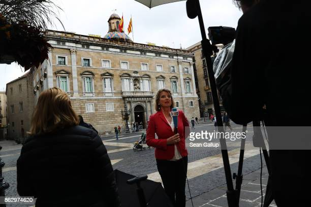 A television crew does a standup report outside the Palau de la Generalitat de Catalunya the building that houses the Catalonian presidency shortly...