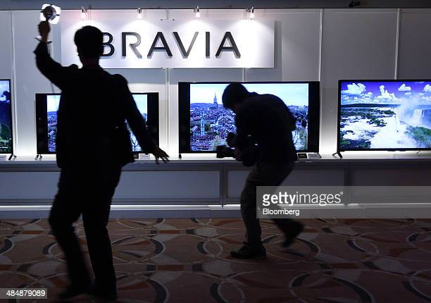 A television crew films Sony Corp 4K Bravia liquidcrystaldisplay televisions displayed during an unveiling in Tokyo Japan on Tuesday April 15 2014...