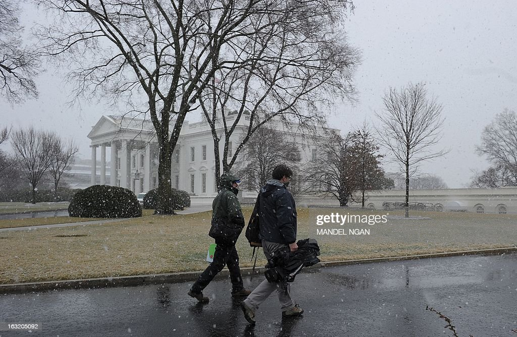 Television crew members walk up the driveway of the White House in snowfall on March 6, 2013 in Washington, DC. A winter storm warning remains in effect until early Thursday. A massive winter storm pounding the northern United States Tuesday grounded 2,600 flights, closed hundreds of schools and made roadways and highways impassible. At least four people were reportedly killed in accidents on icy and snow covered roads and highways. More than a dozen states from Minnesota to Virginia were in the path of the huge storm, which had already dumped as much as two feet (60 centimeters) of snow in Montana and 15 inches (38 centimeters) in North Dakota. Mandel NGAN