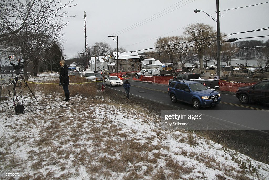 A television crew prepares to do a spot at the location of the Christmas eve shooting and fires on Lake Road on Wednesday, December 26, 2012 in Webster, New York. Law enforcement officials have not publicly identified which gun or guns were used to shoot the four firefighters, two of them fatally, or in what authorities have described as a brief standoff between William Spengler Jr., and a Webster police officer on Christmas eve.