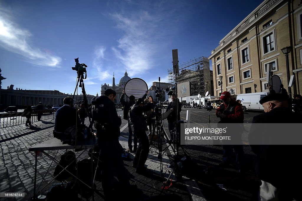 A television crew works on St. Peter's Square prior the mass for Ash Wednesday on February 13, 2013 in St Peter's Basilica at the Vatican. Pope Benedict XVI made his first public appearance on Wednesday since his shock resignation announcement, asking thousands of cheering pilgrims at the Vatican to 'keep praying for me'. AFP PHOTO/ Filippo MONTEFORTE