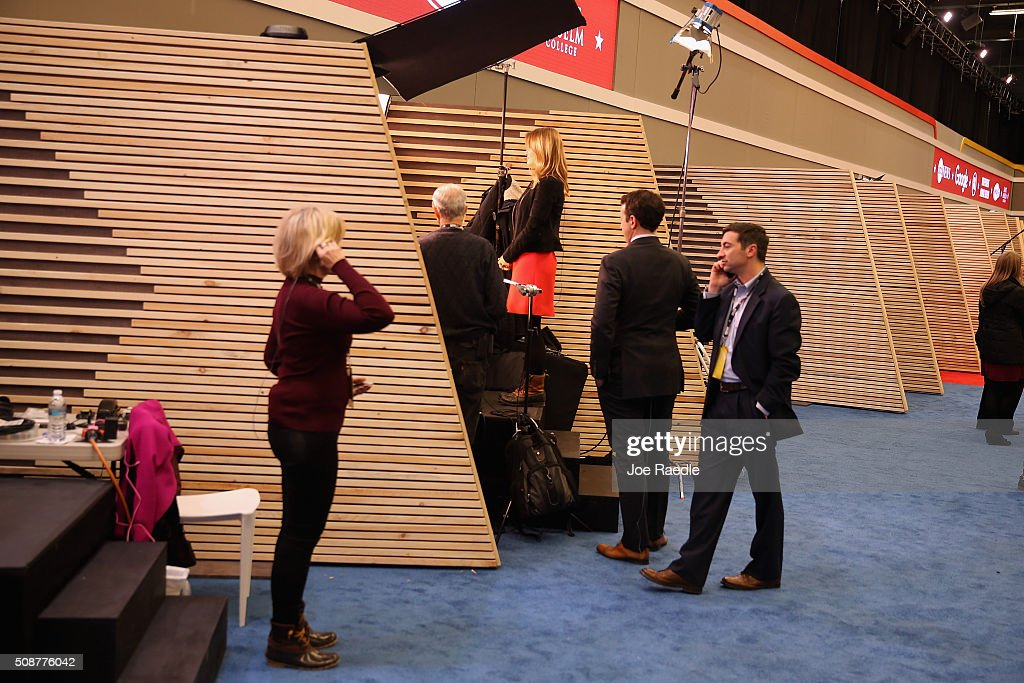 Television crews from various networks set up in wood-walled stalls in the media filing center for the Republican presidential debate at St. Anselm College February 6, 2016 in Manchester, Iowa. Sponsored by ABC News, the Independent Journal Review and Google, this is the final televised debate before voters go to the polls in the 'First in the Nation' New Hampshire primary.