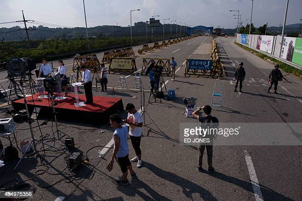 Television crews gather at a checkpoint on the Unification Bridge that leads to the Demilitarized Zone between North and South Korea in Paju on...