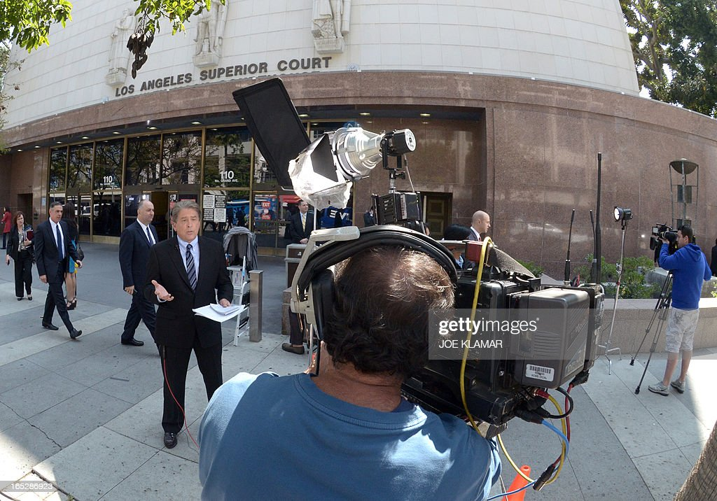 Television crews report live outside the Los Angeles Superior Court where media are reporting from on the first day of trial of Katherine Jackson and Michael's children against concert promoter AEG Live at Los Angeles Superior Court on April 02, 2013 in Los Angeles, California. Jackson heirs reportedly will ask the jury for $40 billion in damages against AEG Live. They blame the company for Dr. Conrad Murray's ill-fated propofol treatment of the late King of Pop.