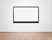 Blank flat screen TV at the wall with clipping path for the screen