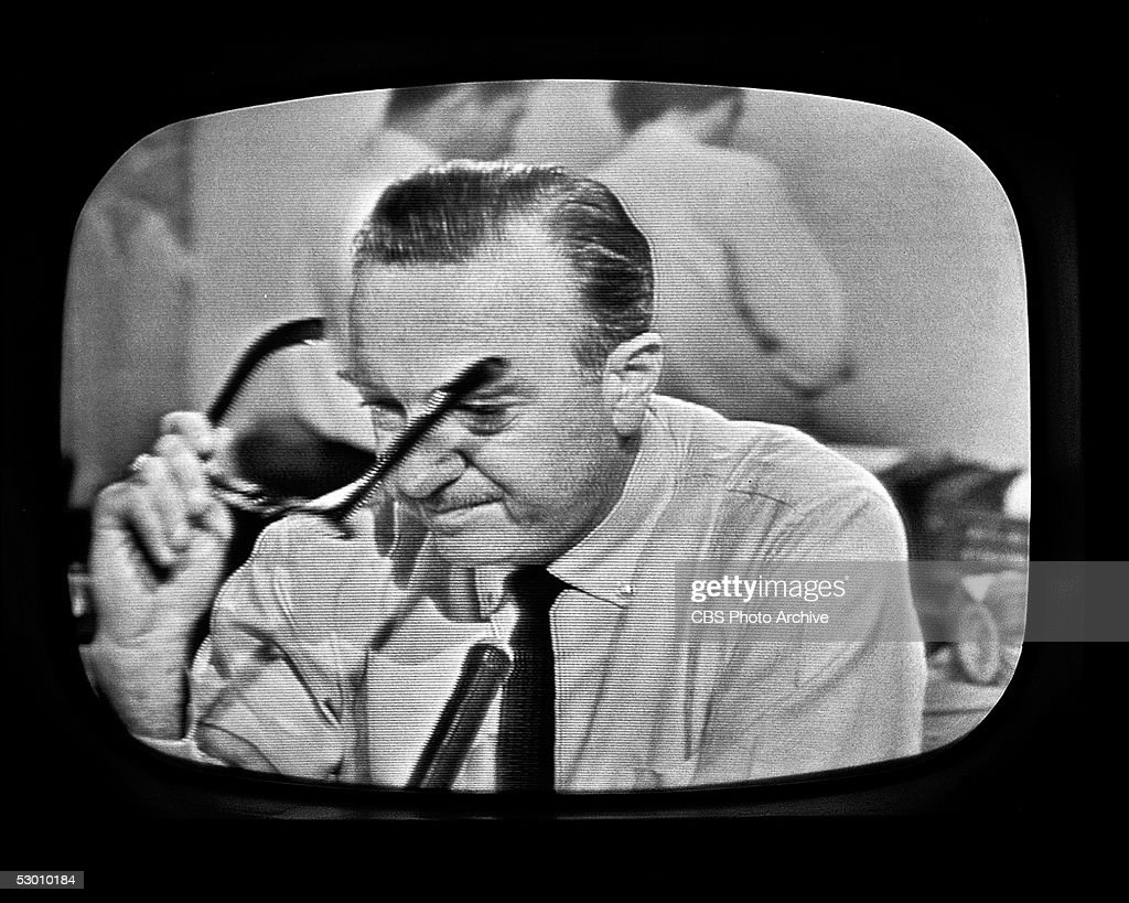 Television frame grab of American broadcast journalist and anchorman Walter Cronkite as he removes his glasses and prepares to announce the death of President John F. Kennedy, November 11, 1963.