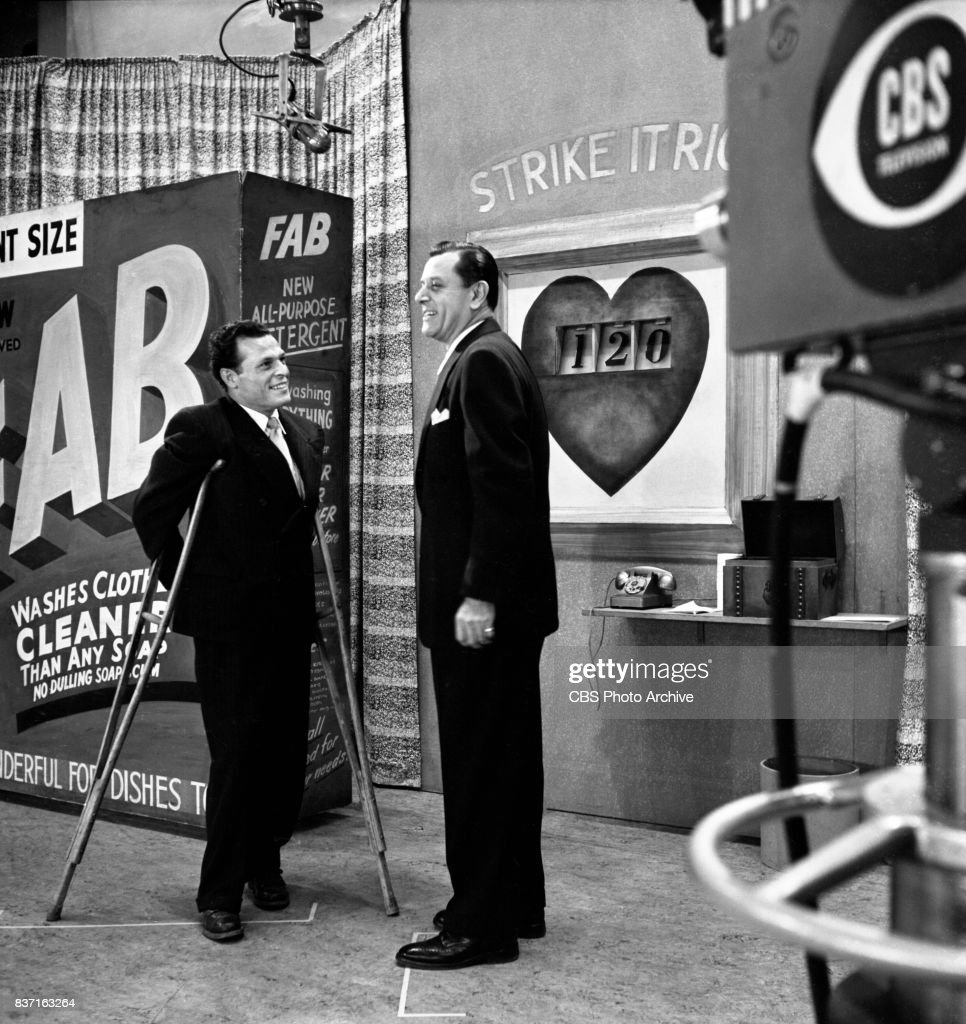 CBS television game show Strike It Rich with host Warren Hull (at right) with a contestant. Image dated April 17, 1953. New York, NY.