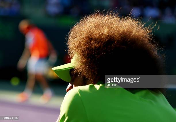 Television Grip Operator looks on during the match between Alexander Zverev of Germany against John Isner during Day 8 of the Miami Open at Crandon...