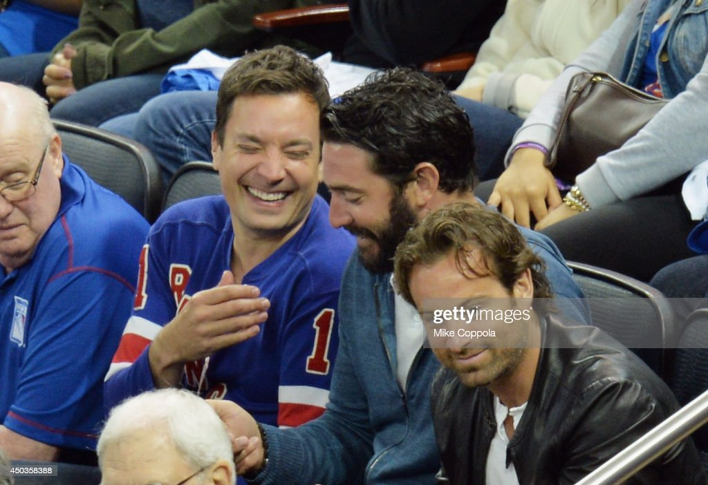 Television host and comedian Jimmy Fallon (2nd from L) and professional baseball player Matt Harvey attends game 3 of the 2014 NHL Stanley Cup Final at Madison Square Garden on June 9, 2014 in New York City.
