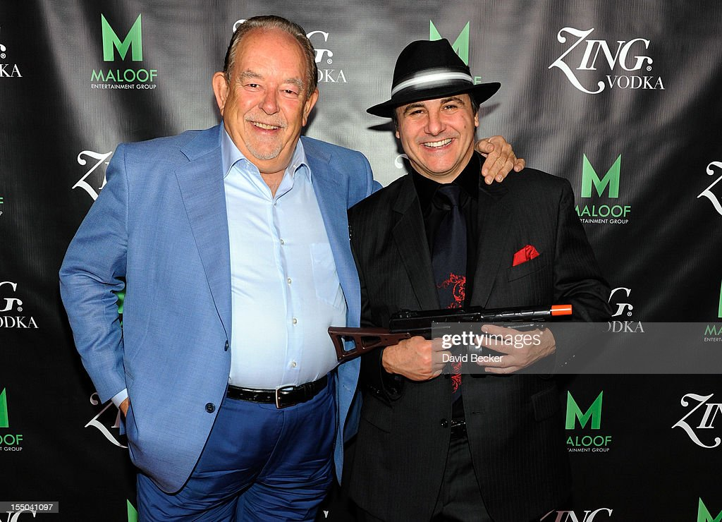 Television host and writer <a gi-track='captionPersonalityLinkClicked' href=/galleries/search?phrase=Robin+Leach&family=editorial&specificpeople=218043 ng-click='$event.stopPropagation()'>Robin Leach</a> (L) and Sacramento Kings co-owner <a gi-track='captionPersonalityLinkClicked' href=/galleries/search?phrase=Gavin+Maloof&family=editorial&specificpeople=240394 ng-click='$event.stopPropagation()'>Gavin Maloof</a> appear at the ZING Vodka's Las Vegas Launch Party at Maloof's home on October 30, 2012 in Las Vegas, Nevada.