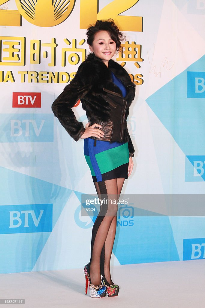 Television host Cao Ying arrives at the red carpet of the 2012 China Trends Awards at BTV Grand Theater on December 22, 2012 in Beijing, China.