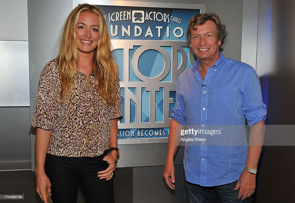 Television host <a gi-track='captionPersonalityLinkClicked' href=/galleries/search?phrase=Cat+Deeley&family=editorial&specificpeople=202554 ng-click='$event.stopPropagation()'>Cat Deeley</a> and producer Nigel Lithgoe attend the Screen Actors Guild Foundation, SAG-AFTRA and Career Transitions for Dancers presents 'Dancers Forum' with <a gi-track='captionPersonalityLinkClicked' href=/galleries/search?phrase=Nigel+Lythgoe&family=editorial&specificpeople=736462 ng-click='$event.stopPropagation()'>Nigel Lythgoe</a>, <a gi-track='captionPersonalityLinkClicked' href=/galleries/search?phrase=Cat+Deeley&family=editorial&specificpeople=202554 ng-click='$event.stopPropagation()'>Cat Deeley</a>, Adam Shankman, Kym Johnson, tWitch and more at SAG Foundation Actors Center on July 25, 2013 in Los Angeles, California.
