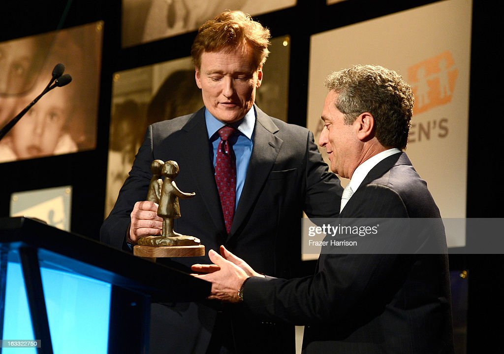 Television Host <a gi-track='captionPersonalityLinkClicked' href=/galleries/search?phrase=Conan+O%27Brien&family=editorial&specificpeople=208095 ng-click='$event.stopPropagation()'>Conan O'Brien</a> presents Rick Rosen with his award at The Alliance For Children's Rights' 21st Annual Dinner at The Beverly Hilton Hotel on March 7, 2013 in Beverly Hills, California.