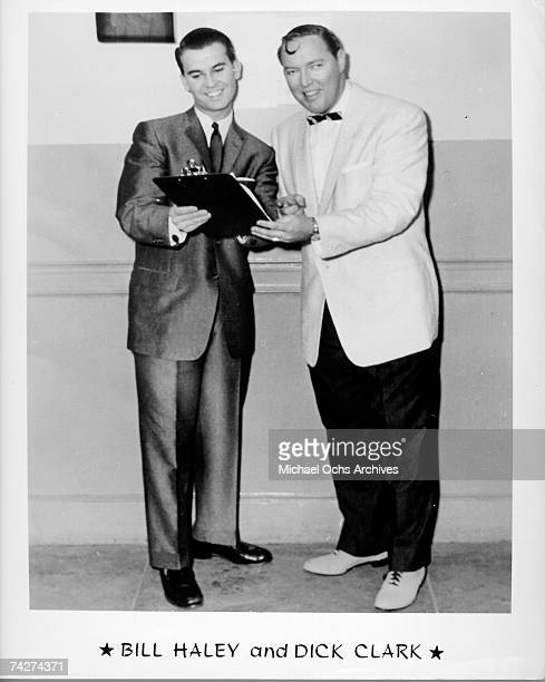 Television host Dick Clark handas a clipboard to rock and roll pioneer Bill Haley in 1955 in Philadelphia Pennsylvania