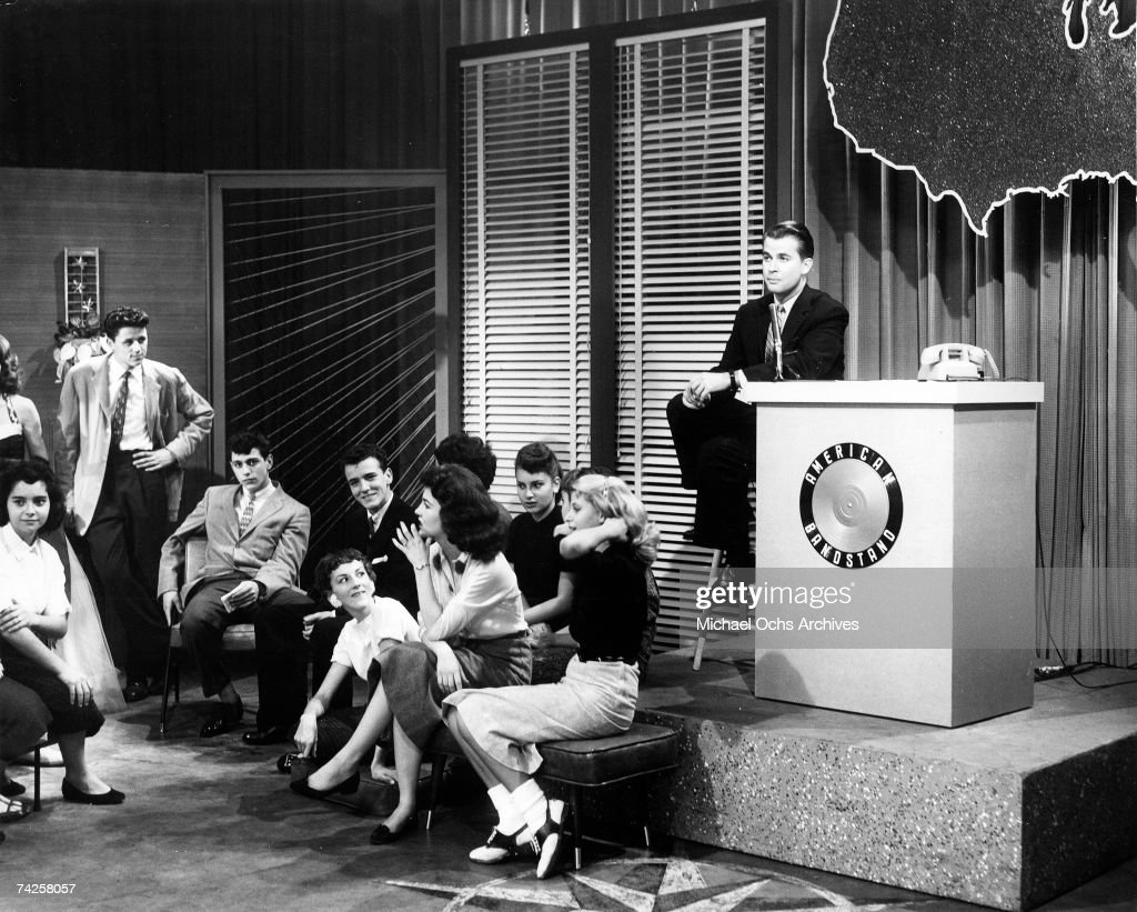 Television host Dick Clark presides over the set of his show 'American Bandstand' as teenagers dance to top 40 popular music in circa 1958 in...