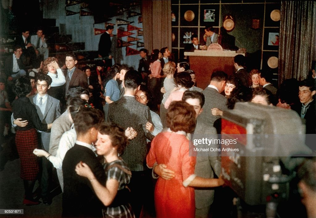 Television host Dick Clark presides over the set of his show 'American Bandstand' as teenagers dance to top 40 popular music circa 1957 in...