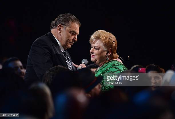 Television host Don Francisco looks on as recording artist Paquita la del Barrio performs in the audience during the 14th Annual Latin GRAMMY Awards...