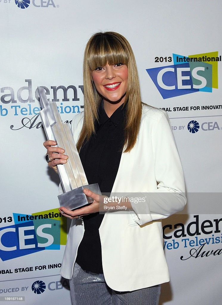 Television host Grace Helbig poses with the IAWTV award for Best Tapped Host at the IAWTV Awards at the CES 2013 Show at the Palazzo Theater at the Palazzo Resort Hotel/Casino on January 8, 2013 in Las Vegas, Nevada.