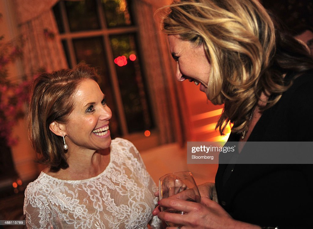 Television host <a gi-track='captionPersonalityLinkClicked' href=/galleries/search?phrase=Katie+Couric&family=editorial&specificpeople=202633 ng-click='$event.stopPropagation()'>Katie Couric</a>, left, attends the Bloomberg Vanity Fair White House Correspondents' Association (WHCA) dinner afterparty in Washington, D.C., U.S., on Saturday, May 3, 2014. The WHCA, celebrating its 100th anniversary, raises money for scholarships and honors the recipients of the organization's journalism awards. Photographer: Pete Marovich/Bloomberg via Getty Images