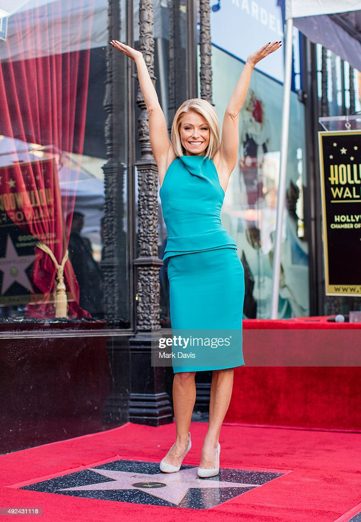 Television host <a gi-track='captionPersonalityLinkClicked' href=/galleries/search?phrase=Kelly+Ripa&family=editorial&specificpeople=202134 ng-click='$event.stopPropagation()'>Kelly Ripa</a> poses with her star on the Hollywood Walk of Fame on October 12, 2015 in Hollywood, California.