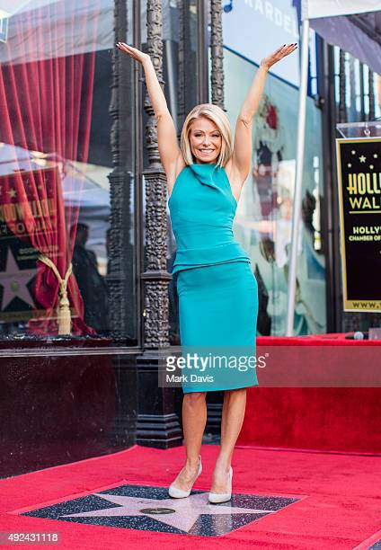 Television host Kelly Ripa poses with her star on the Hollywood Walk of Fame on October 12 2015 in Hollywood California