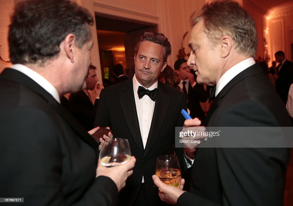 Television host Piers Morgan, from left, actor Matthew Perry, and Bradley Whitford attend the Bloomberg Vanity Fair White House Correspondents' Association (WHCA) dinner afterparty in Washington, D.C., U.S., on Saturday, April 27, 2013. The 99th annual dinner raises money for WHCA scholarships and honors the recipients of the organization's journalism awards. Photographer: Andrew Harrer/Bloomberg via Getty Images