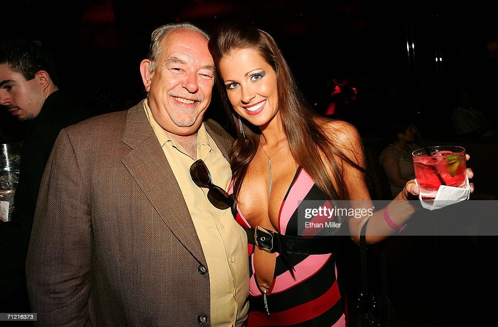 Television host Robin Leach and actress/model Monique Benevento pose inside at Dennis Hopper's birthday dinner at Tao Nightclub at the Venetian Resort Hotel Casino during the CineVegas film festival on June 15, 2006 in Las Vegas, Nevada.