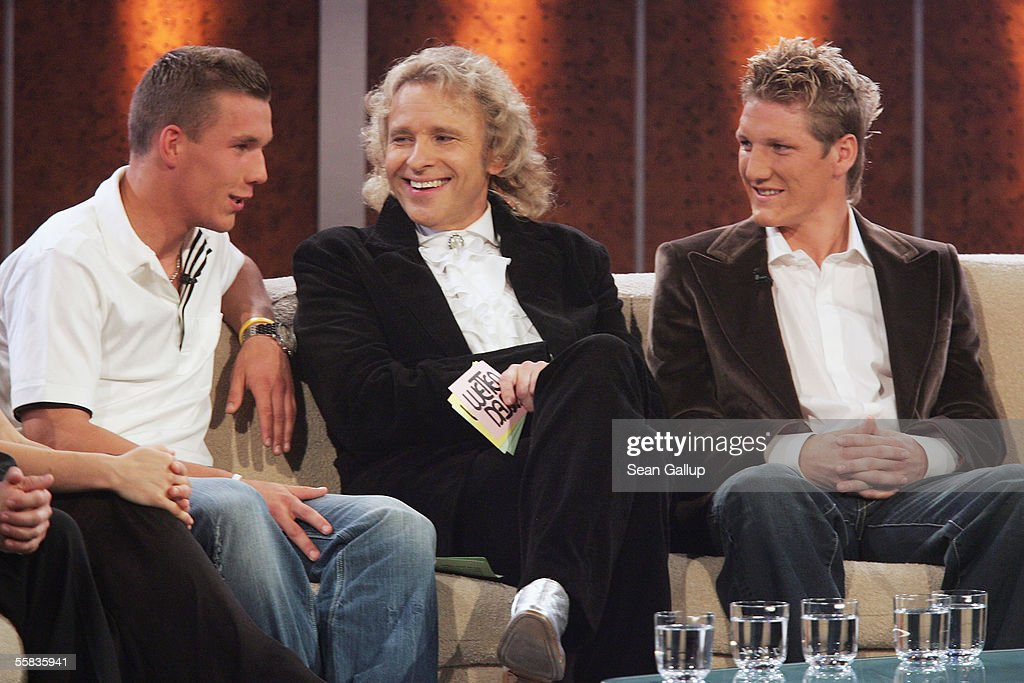 Television host Thomas Gottschalk chats with soccer players Lukas Podolski and Bastian Schweinsteiger during the live broadcast of 'Wetten dass' on...