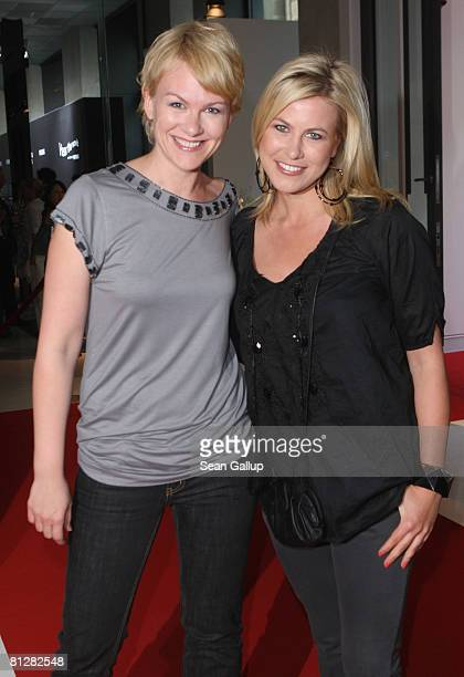 Television hostess Nadine Krueger and friend Karen Heinrichs attend the opening of the Bryan Adams photo exhibition 'Hear the World' on May 29 2008...
