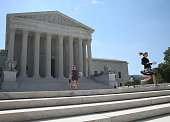 Television interns and producers run to their reporters after a court decision was released at the US Supreme Court June 22 2015 in Washington DC his...