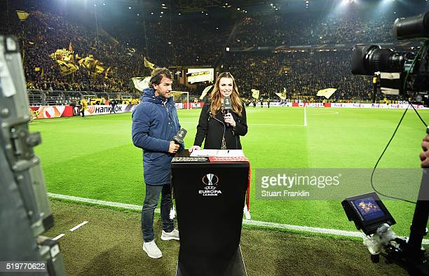 Television interviewer Laura Wontorra interview KarlHeinz Riedle before the UEFA Europa League quarter final first leg match between Borussia...