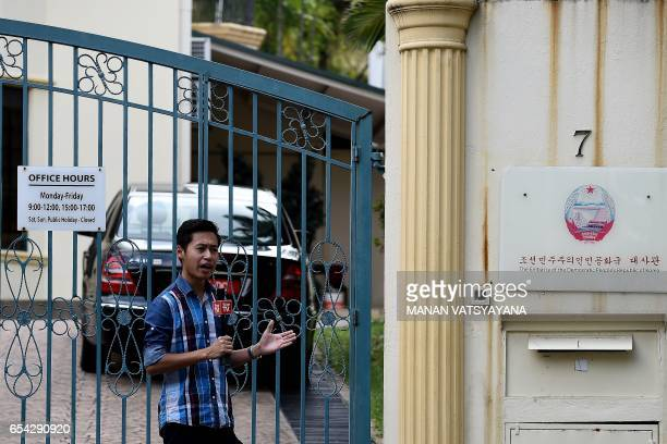 A television journalist reports from outside the compounds of the North Korean embassy in Kuala Lumpur on March 17 2017 Malaysian investigators used...