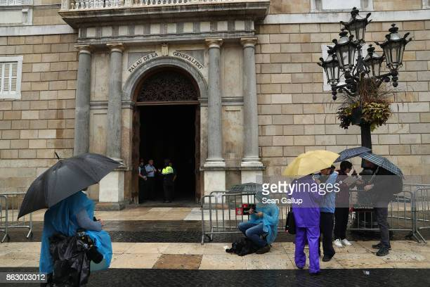 Television journalists wait outside the Palau de la Generalitat de Catalunya the building that houses the Catalonian presidency in the hope that...